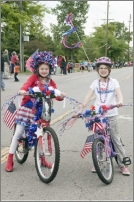 Two girls with their bikes from the Memorial Day Parade
