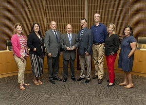 Mayor posed with Parks, Recreation and Cultural Services staff holding CAPRA Award
