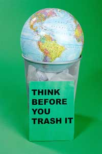 Globe in Garbage Can - Think Before You Trash It