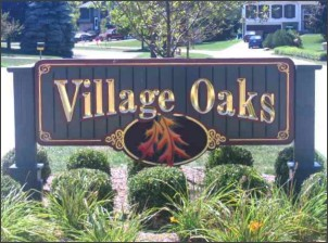 Village Oaks sign