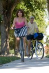 Older adult couple riding bikes