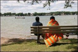 Couple sitting on bench looking at Walled Lake