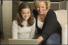 Mother and daughter looking at computer screen.