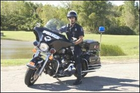 Officer on motorcycle posed.