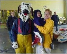 Mom and child with Sparky the Fire Dog.