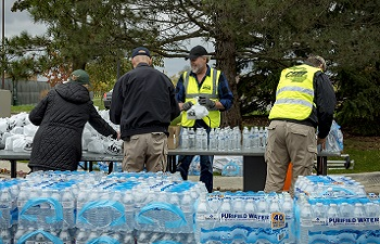 Volunteers Giving Out Water
